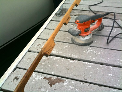 Sanding the handrail on the dock using a much to large orbital sander
