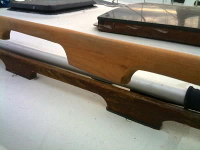 Before and after photo of the sanded teak handrail ready for stain