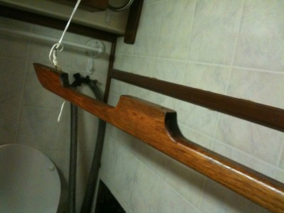 Hand rail hung up inside the boat cabin