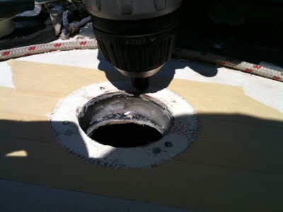 Drilling new screw holes for the waste deck fill.